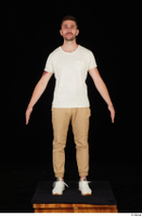 Trent brown trousers casual dressed standing white sneakers white t shirt whole body 0001.jpg